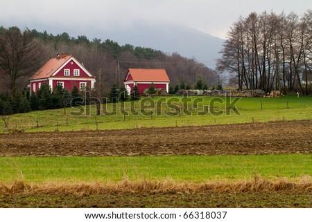 Autumn field in village - stock photo