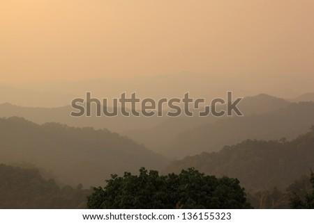 Autumn foggy landscape in Kaeng krachan national park, THAILAND - stock photo