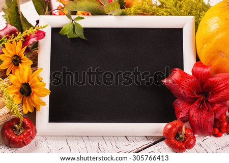 Autumn frame with flowers, vegetables and leaves. Harvesting, thanksgiving day or fall concept over white wooden background. Space for text. Selective focus - stock photo