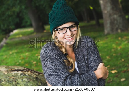 Autumn girl wearing sweater outdoor - stock photo