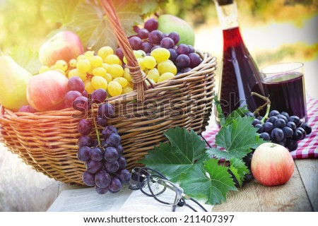 Autumn harvest  - Grapes and red wine - stock photo