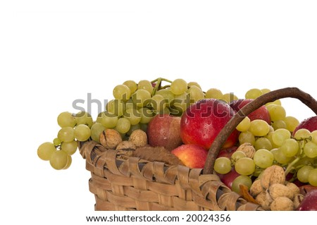 Autumn harvest in a wicker basket on white background - stock photo