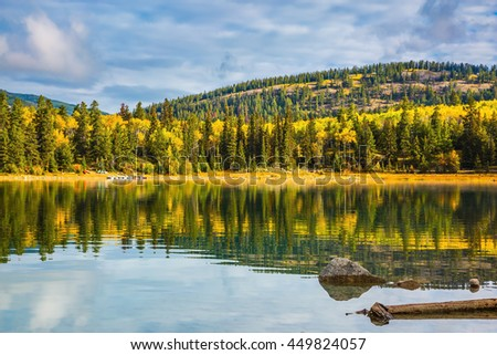 Autumn in Jasper Park, Canadian Rockies. Charming Patricia Lake amongst the evergreen forests, yellow bushes and mountains - stock photo