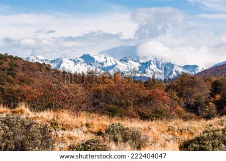 Autumn in Patagonia. Cordillera Darwin, part of Andes range, Isla Grande of Tierra del Fuego, Chilean territory, view from the Argentine side - stock photo