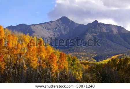Autumn in rocky mountains - stock photo