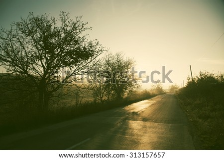 Autumn in the mountains - rural foggy landscape - stock photo