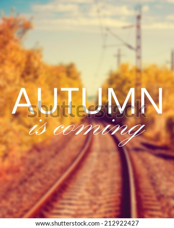 Autumn is coming text on blurry autumn background - stock photo
