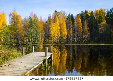 Autumn lake view with a wooden pier - stock photo