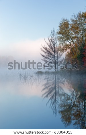 Autumn landscape at dawn of Council Lake in fog, Michigan's Upper Peninsula, USA - stock photo