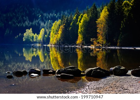 autumn landscape in the mountains with beautiful water reflections - stock photo