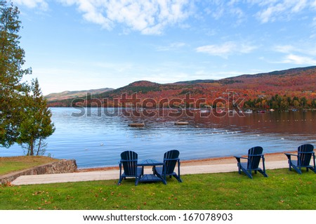 autumn landscape Mont Tremblant with benches facing the lake - stock photo