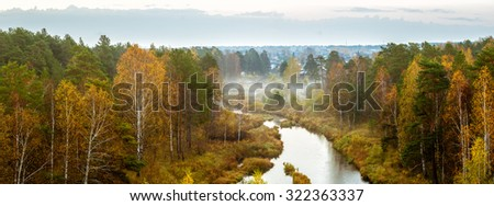 Autumn landscape on a misty morning in a forest and a river, Russia, Ural - stock photo