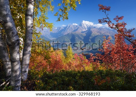 Autumn landscape. Sunny day in the mountains. View of the mountain Ushba with Mount Mheer. Main Caucasian ridge. Zemo Svaneti, Georgia  - stock photo