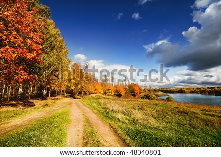 Autumn landscape with a path - stock photo