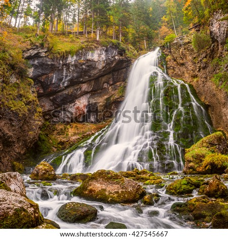 Autumn landscape with beautiful waterfall in mountain - stock photo