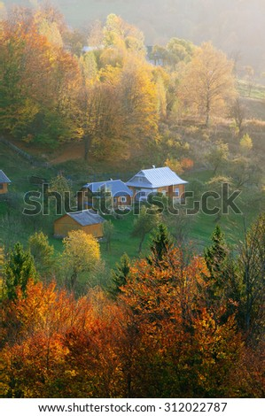 Autumn landscape with houses in a mountain village. Carpathians, Ukraine, Europe - stock photo
