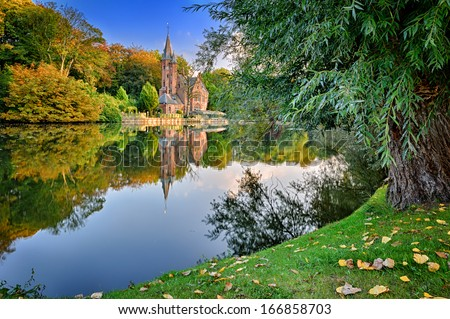 Autumn landscape with lake and old mansion. Bruges, Belgium - stock photo