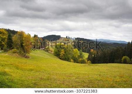 Autumn landscape with overcast sky in Beskydy - stock photo