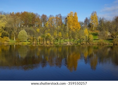 Autumn landscape with river and yellow trees in Pskov, Russia - stock photo