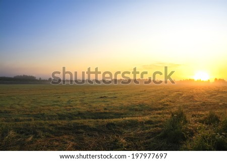 autumn landscape with sunrise and fog - stock photo