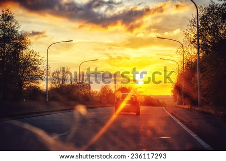 Autumn landscape with sunset road  - stock photo