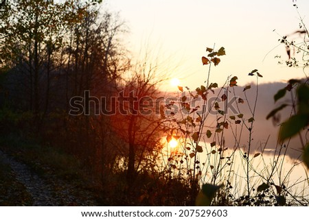 Autumn landscape with the sunset. Beautiful scene of divine - stock photo