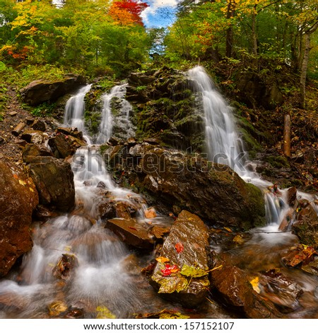 Autumn landscape with waterfall in the mountains - stock photo