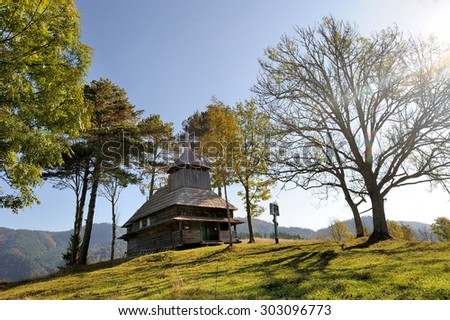 Autumn landscape with wooden orthodox church in mountain - stock photo