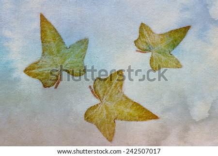 autumn leaf on an ancient paper background - stock photo