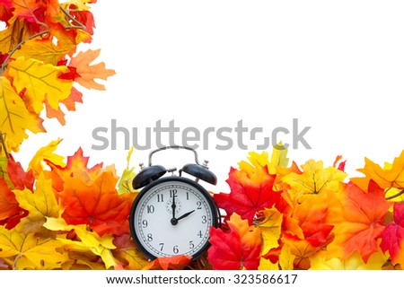 Autumn Leaves Background, Autumn Leaves and Alarm Clock isolated on white with space for your message - stock photo