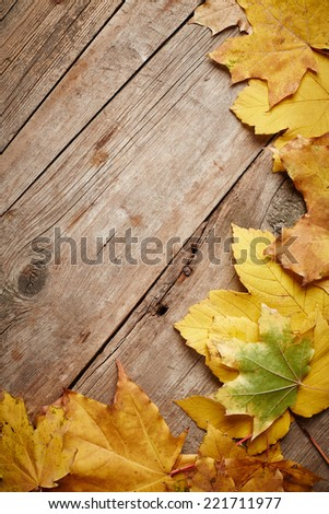 Autumn leaves on wooden background - stock photo