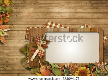 Autumn leaves,pumpkins,frame on a wooden background - stock photo