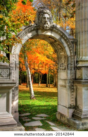 Autumn leaves, stone arch, classic columns. - stock photo