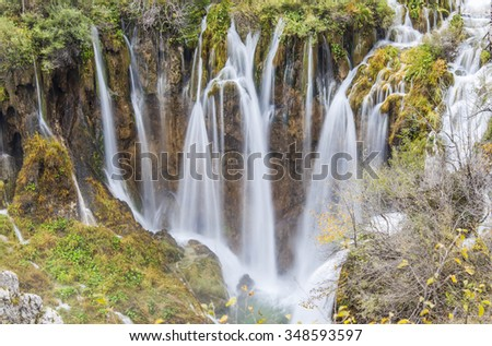 Autumn majestic view on turquoise water and falls in the Plitvice Lakes National Park, Croatia. - stock photo
