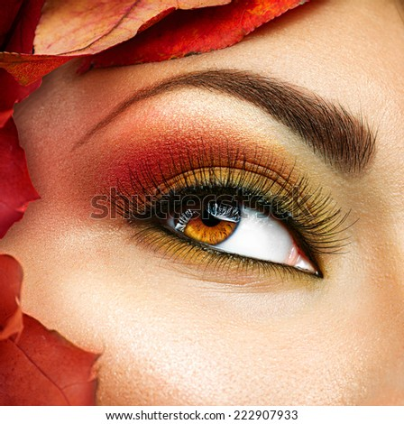 Autumn make up for brown eyes. Closeup fashion makeup. Perfect face skin, autumn warm colors of eyeshadows, long eyelashes. - stock photo