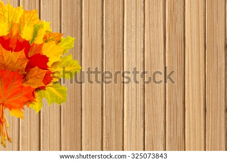 Autumn maple leaves on wooden table background - stock photo