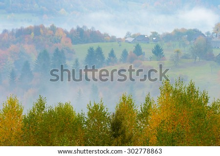 Autumn mist. Mountain village. Carpathians, Ukraine, Europe - stock photo