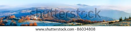Autumn misty morning mountain panorama (Carpathian , Ukraine). Five shots stitch image. - stock photo