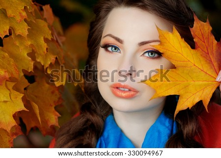 Autumn model, bright make up. woman on background fall landscape leaves of trees. Girl Model on autumn season. Fashion people. - stock photo