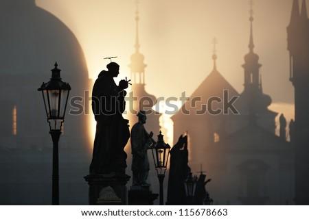 Autumn morning - Statues on Charles Bridge, Prague, Czech Republic - stock photo