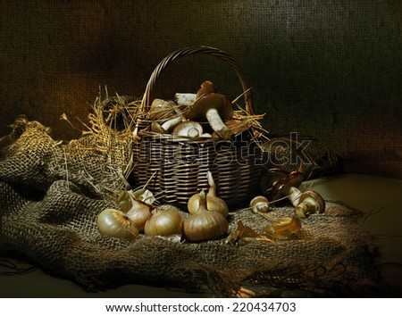 Autumn mushrooms in a basket - stock photo