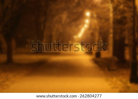Autumn night street blurred background - stock photo