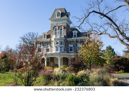 Autumn on the grounds of the Cylburn mansion and Arboretum the largest public garden in the City of Baltimore, Maryland.  The mansion was completed in 1888. - stock photo