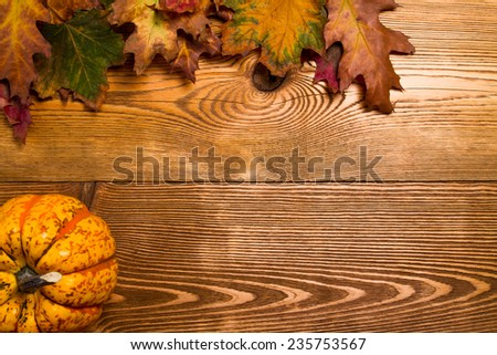 Autumn orange and yellow pumpkins on wooden table - stock photo