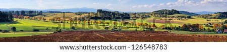 Autumn panorama in the hills - stock photo