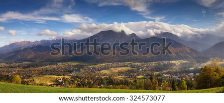 Autumn panorama of High Tatra mountains and Zakopane, Poland - stock photo