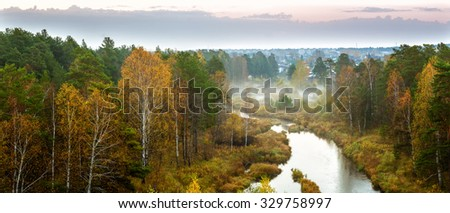 autumn panorama of the morning forest river fog, Russia, Ural - stock photo