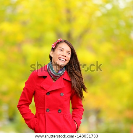 Autumn people - fall woman smiling happy walking in colorful forest foliage. - stock photo