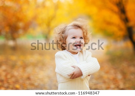 Autumn portrait of cute curly girl - stock photo
