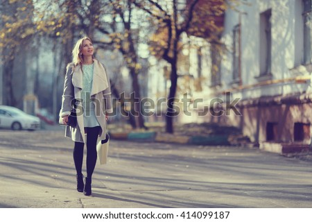 Autumn portrait of happy girl on a walk - stock photo